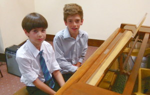 2 boys at piano