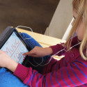 Little girl using an iPad