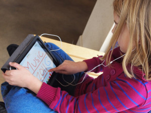 Little girl using an iPad