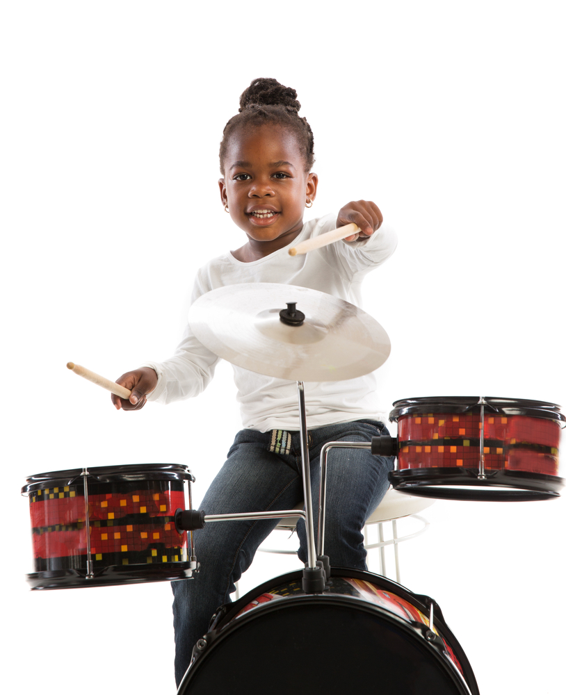 little girl playing drums