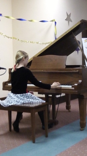 girl playing piano at a Piano Power recital