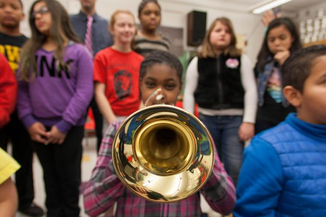girl playing horn in music class