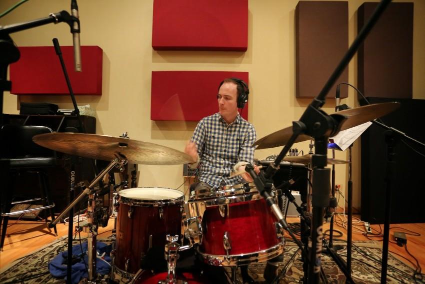 Lucas Gillan playing drums