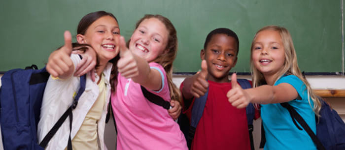 kids giving thumbs up sign