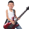little boy rocking out on guitar