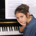 bored girl at piano