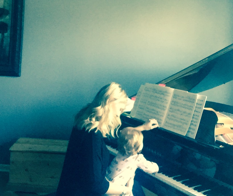 Mom and daughter at piano