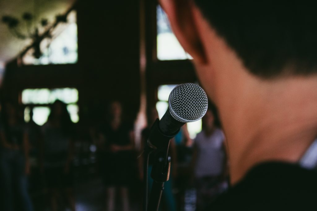 view from man on stage singing into a mic