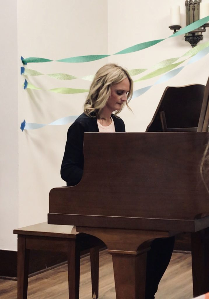 Adult woman playing the piano at a recital