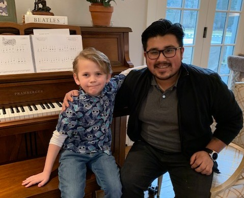 Piano teacher & student at piano