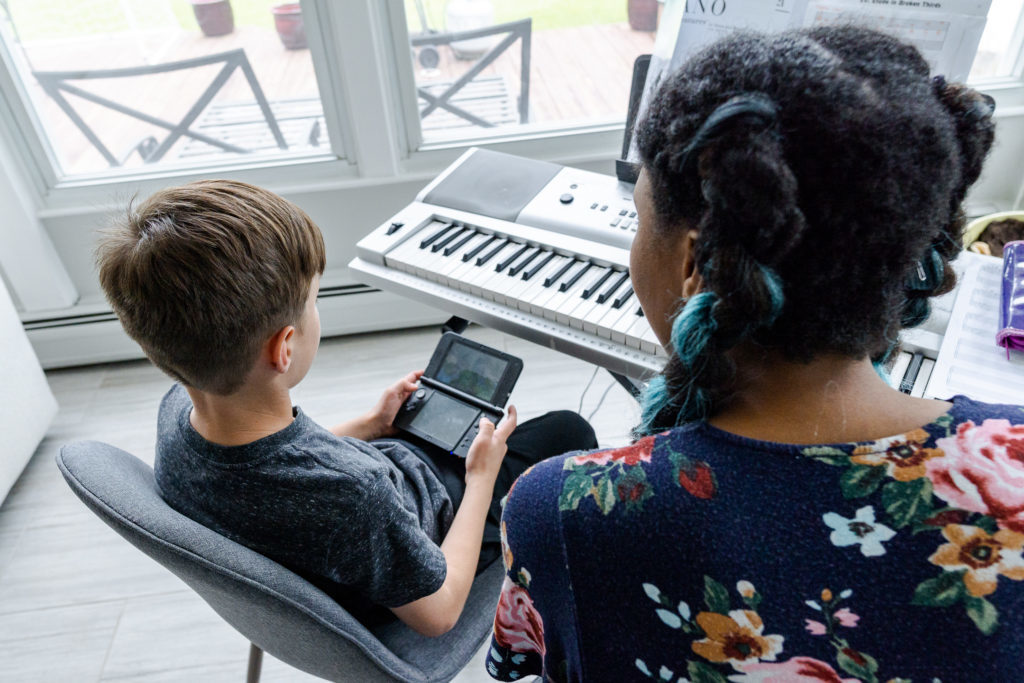 piano teacher with student using an app