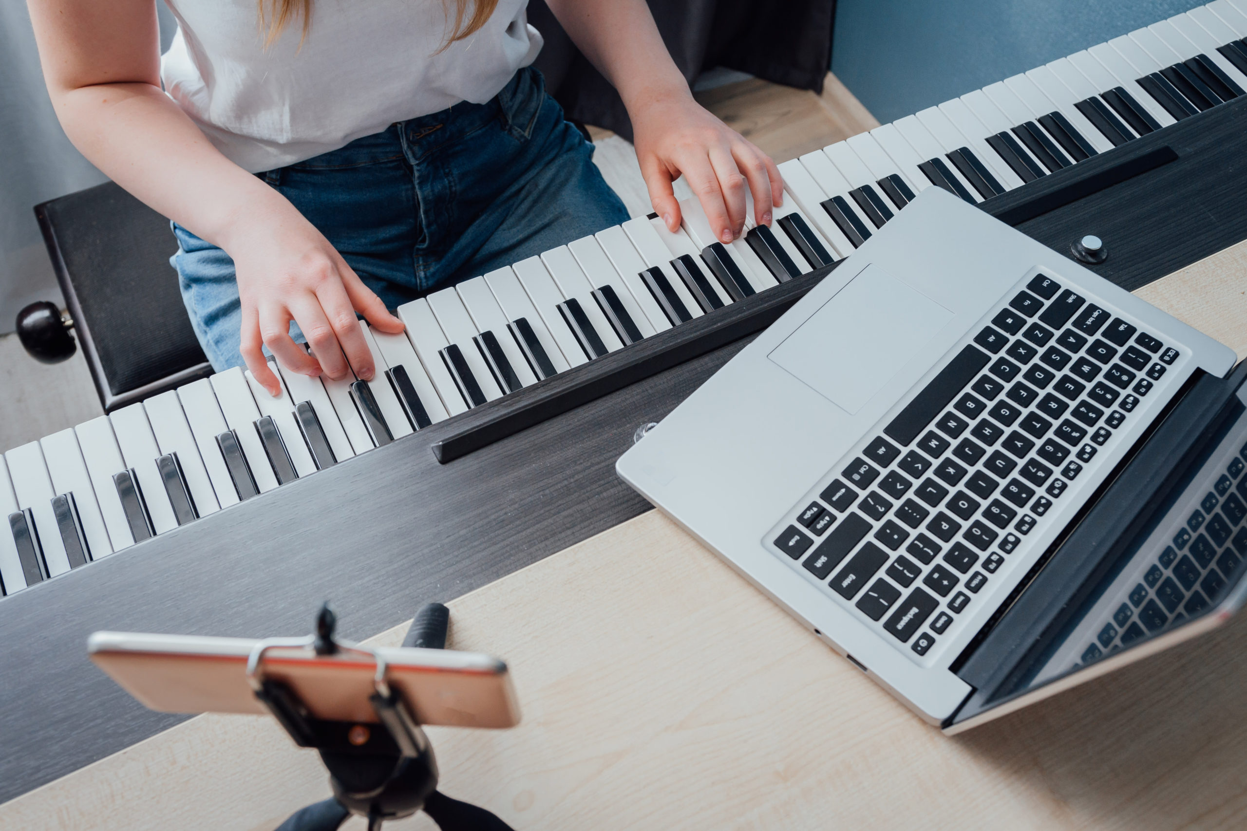 woman taking online piano lesson